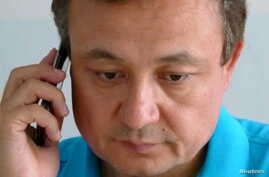 Chinese Uighur activist Dolkun Isa, seen in this July, 6, 2015 photo, is chairman of the World  Uighur Conference, which advocates human rights and democracy.  India has revoked a tourist visa extended to him, apparently due to pressure from China.