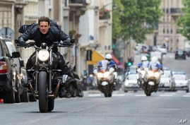 """FILE - This image released by Paramount Pictures shows Tom Cruise in a scene from """"Mission: Impossible - Fallout."""" Tom Cruise has outrun Winnie-the-Pooh at the box office. """"Mission: Impossible -- Fallout"""" topped ticket sales for the second straight w"""
