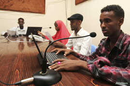 Qaran radio reporters broadcast morning news from their studio in the capital Mogadishu, June 28, 2013.