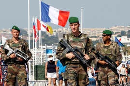 Soldiers patrols on the Promenade des Anglais in Nice, southern France, July 19, 2016.