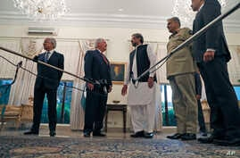 FILE - U. S. Secretary of State Rex Tillerson, center left, speaks with Pakistani Prime Minister Shahid Khaqan Abbasi, before their meeting at the Prime Minister's residence, Oct. 24, 2017, in Islamabad, Pakistan.