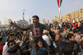 Egyptian protesters shout slogans against Defense Minister Gen. Abdel-Fattah el-Sissi as they march in Tahrir Square, in Cairo, Egypt, Nov. 19, 2013.