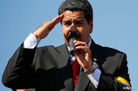 Venezuela's Vice President Nicolas Maduro speaks to thousands of supporters of Venezuela's late President Hugo Chavez as they wait to view his body in state at the Military Academy in Caracas March 7, 2013. Chavez, a former paratrooper, died on Tuesd