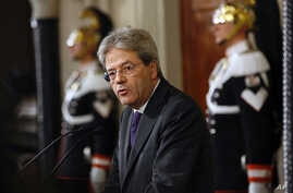 Premier-designate Paolo Gentiloni speaks at the Quirinale presidential palace, in Rome, Monday, Dec. 12, 2016. Gentiloni said he succeeded in forming a new government, ending a political crisis, after Matteo Renzi resigned on Dec. 7, so the country c...