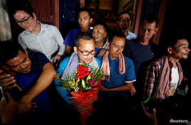 Members of the dissolved opposition Cambodia National Rescue Party (CNRP), pose for a picture after they were released from jail by King Norodom Sihamoni's pardon in Phnom Penh, Cambodia, Aug. 28, 2018.