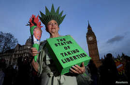 A demonstrator dressed as the Statue of Liberty takes part in a protest against U.S. President Donald Trump in London, Feb. 20, 2017.