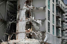 This Sept. 24, 2017 photo shows an apartment building that was partially destroyed during the 7.1 magnitude earthquake, on Emiliano Zapata Avenue in Mexico City. The eco-friendly apartment building with its wood-paneled balconies and a solar-paneled