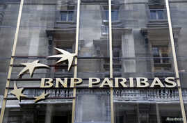 FILE - The logo of BNP Paribas is seen on the bank's building in Paris, May 30, 2014.