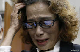 Junko Ishido, mother of Japanese journalist Kenji Goto who was slain by Islamic State militants, speaks to reporters at her house in Tokyo, Feb. 1, 2015.