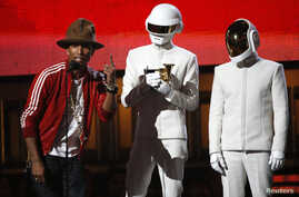 """Pharrell Williams accepts the award for record of the year for Daft Punk for """"Get Lucky"""" at the 56th annual Grammy Awards in Los Angeles, Jan. 26, 2014."""