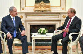 Russian President Vladimir Putin, right, speaks with Israeli Prime Minister Benjamin Netanyahu during their meeting at the Kremlin in Moscow, July 11, 2018.