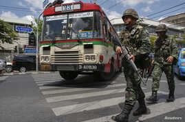 Thai soldiers patrol on a road near an army club during a military coup in Bangkok, May 23, 2014.
