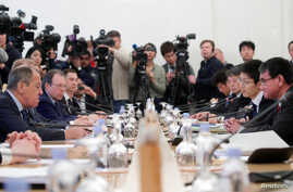 Russian Foreign Minister Sergei Lavrov (L) and his Japanese counterpart Taro Kono (R) attend a meeting in Moscow, Russia, Jan. 14, 2019.
