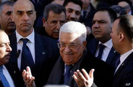 Palestinian President Mahmoud Abbas, center, attends the inauguration ceremony of the Palestinian embassy to the Holy See at the Vatican, Jan. 14, 2017.