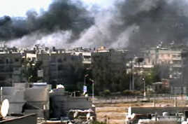 This video image taken from amateur video and broadcast by Bambuser/Homslive shows a series of devastating explosions rocking the central Syrian city of Homs, Syria, Monday, June 11, 2012.