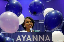Balloons fall around Democratic candidate for U.S House of Representatives Ayanna Pressley at her primary election night rally in Boston, Sept. 4, 2018.