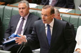 Australia's Prime Minister Tony Abbott speaks about the nation's new anti-extremism strategy during a question time at Parliament House in Canberra, Australia, Feb. 23, 2015.