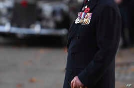 Prince Charles arrives for a remembrance service at the Guards' Chapel, Wellington Barracks, London, on the 100th anniversary of the signing of the Armistice which marked the end of World War I, Nov. 11, 2018.