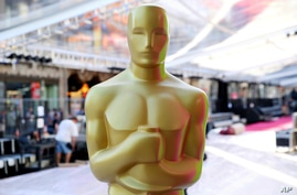 Oscar statue appears during the setup for the Academy Awards in Los Angeles.