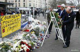 U.S. Secretary of State John Kerry (L) lays a wreath with French Foreign Minister Laurent Fabius at the site of an attack at a Jewish supermarket  in Paris, January 16, 2015.