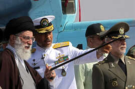 """A handout picture made available by the official website of Iranian Supreme Leader Ayatollah Ali Khamenei, shows the later (L) touring """"Jamran"""", Iran's first domestically built warship, during its unveiling ceremony at an undisclosed location in sout"""