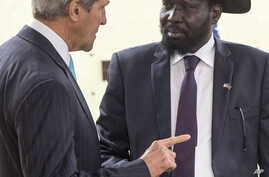 South Sudan's President Salva Kiir (R) listens as he greets U.S. Secretary of State John Kerry at the President's Office in Juba, South Sudan, May 2, 2014.