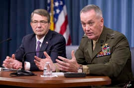 Joint Chiefs Chairman Gen. Joseph Dunford (r) with Defense Secretary Ash Carter, during a news conference at the Pentagon, March 25, 2016.