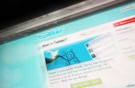 FILE - This picture taken on July 20, 2009 in Paris shows the frontpage of Twitter, a leading Internet microblogging site. Turkey's prime minister accused Twitter on April 12, 2014 of tax evasion after the micro-blogging site was used to spread a num