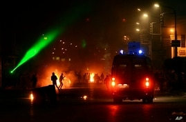 Clashes erupt between demonstrators and security forces outside a government building in the Nile Delta city of Mansoura, Egypt, March 3, 2013.
