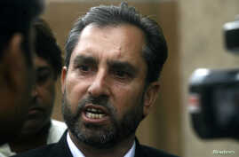 FILE - Samiullah Afridi, lawyer for Shakil Afridi who ran a fake vaccination campaign to try help U.S. officials find al-Qaida chief Osama bin Laden, speaks to the media after appearing before the court in Peshawar.