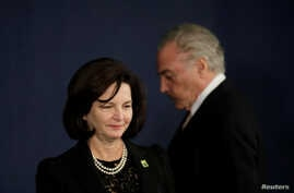 Brazil's President Michel Temer reacts near the Brazil's new Attorney General Raquel Dodge during her inauguration, in Brasilia, Brazil, Sept. 18, 2017.