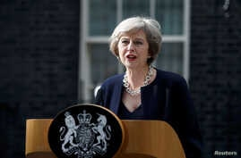 FILE - British Prime Minister Theresa May speaks to reporters outside No. 10 Downing Street in London, July 13, 2016.