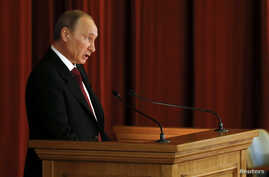 Russian President Vladimir Putin delivers a speech during a meeting with Russian ambassadors, envoys and diplomats at the Foreign Ministry headquarters in Moscow July 1, 2014.