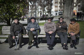 Retirees enjoy the sunshine in Bermeo, Spain, March 6, 2015. National Statistics Institute data indicate that if trends continue, Spain's percentage of the population over 65 will rise from today's level of 18.2 percent to 38.7 percent in 2064.