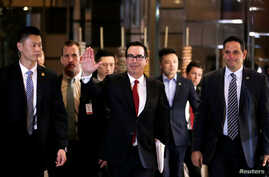 U.S. Treasury Secretary Steven Mnuchin, a member of the U.S. trade delegation to China, waves to the media as he returns to a hotel in Beijing, China, May 3, 2018.
