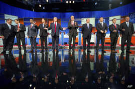 Republican presidential candidates, from left, Chris Christie, Marco Rubio, Ben Carson, Scott Walker, Donald Trump, Jeb Bush, Mike Huckabee, Ted Cruz, Rand Paul and John Kasich take the stage for their debate at Quicken Loans Arena in Cleveland, Aug....