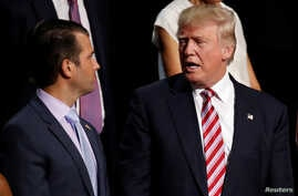 FILE - Donald Trump Jr. talks with his father, then-Republican presidential candidate Donald Trump, during the 2016 Republican National Convention in Cleveland, Ohio, July 20, 2016.