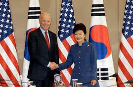 South Korean President Park Geun-hye, right, shakes hands with U.S. Vice President Joe Biden before their meeting at the presidential Blue House in Seoul, South Korea, Friday, Dec. 6, 2013.