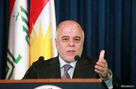 FILE - Iraqi Prime Minister Haider al-Abadi addresses the media during a news conference.