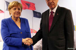 FILE - Turkish President Tayyip Erdogan meets with Germany's Chancellor Angela Merkel in Brussels, Belgium, July 11, 2018.