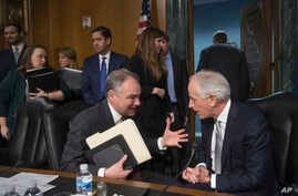 FILE - Senate Foreign Relations Committee Chairman Bob Corker, R-Tenn., right, confers with committee member Sen. Tim Kaine, D-Va., on Capitol Hill in Washington, Jan. 11, 2017,