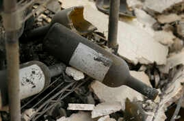 The remains of burned bottles of wine are seen at the Signorello Estate winery in Napa, Calif., Oct. 10, 2017.