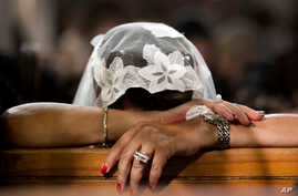 FILE - A Coptic Christian grieves during prayers for the departed, remembering the victims of Thursday's crash of EgyptAir flight 804, at Al-Boutrossiya Church, the main Coptic Cathedral complex, in Cairo, Egypt,May 22, 2016.