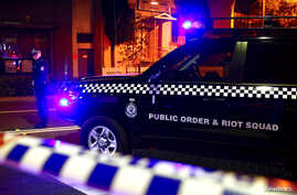 A policeman stands on a street blocked to the public after Australian counter-terrorism police arrested four people in raids across several Sydney suburbs in Australia, July 29, 2017.