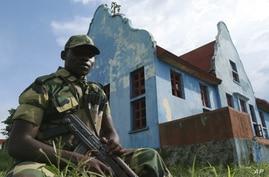 A soldier stands guard at an M23 rebel training camp in Rumangabo, eastern Congo, Oct. 23, 2012.