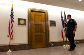 A U.S. Capitol Police officer walks past Sen. Roger Wicker's office in the Dirksen Senate Office Building on Capitol Hill, Washington, April 16, 2013.