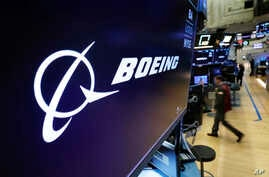 The Boeing logo appears above a trading post on the floor of the New York Stock Exchange before the opening bell, Monday, March 11, 2019.