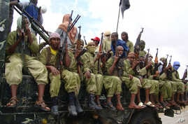 FILE - Al-Shabab fighters sit on a truck as they patrol in Mogadishu, Somalia,Oct. 30, 2009.