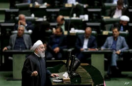 "Iranian President Hassan Rouhani speaks during parliament's open session on a confidence vote for four new ministers, in Tehran, Oct. 27, 2018. Rouhani urged parliament to approve four new ministers and help his government ""resist"" and ""fight"" the U."