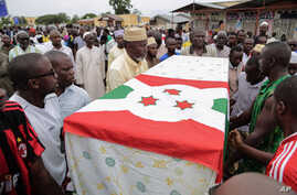 FILE - In this Sunday, May 24, 2015 file photo, men carry the coffin of UPD-Zigamibanga party leader Zedi Feruzi during his funeral in Bujumbura, Burundi. Amnesty International called for investigations Dec. 22, as Burundi's top security body rejecte